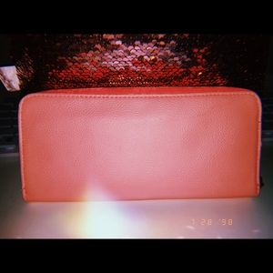 Handbags - A pink zip up wallet